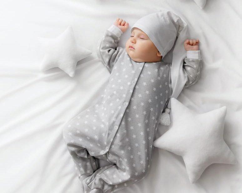 baby on bed sleeping